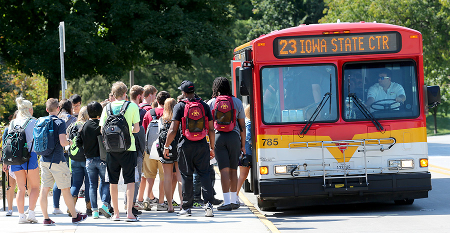 Students line up to board a CyRide bus