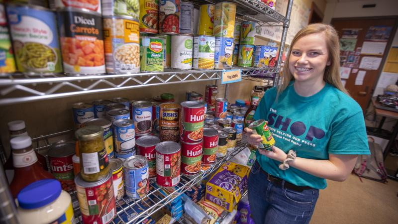 Belinda Heckman, president of The Shop (Students Helping Our Peers) in the food pantry at the Frederiksen Court Community Center.