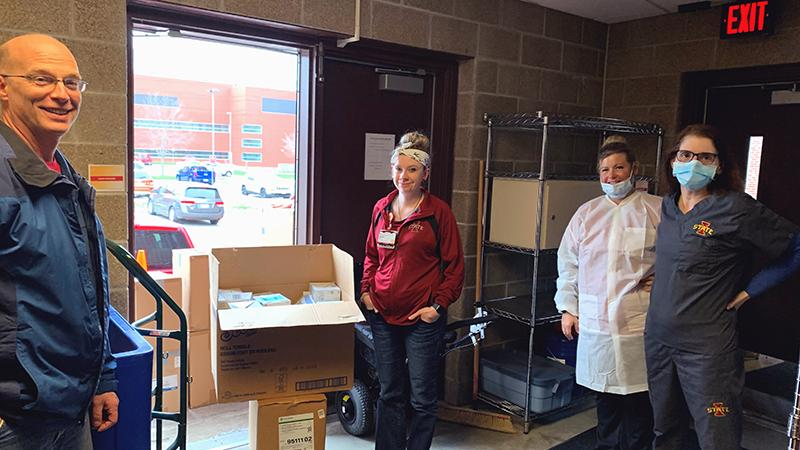 Associate director of environmental health and safety Bill Diesslin delivers donated personal protection supplies to the Thielen Student Health Center staff Friday. Pictured (l-r) are Calyn Tope, Emily Swenson and Julie Halbur. Image supplied.