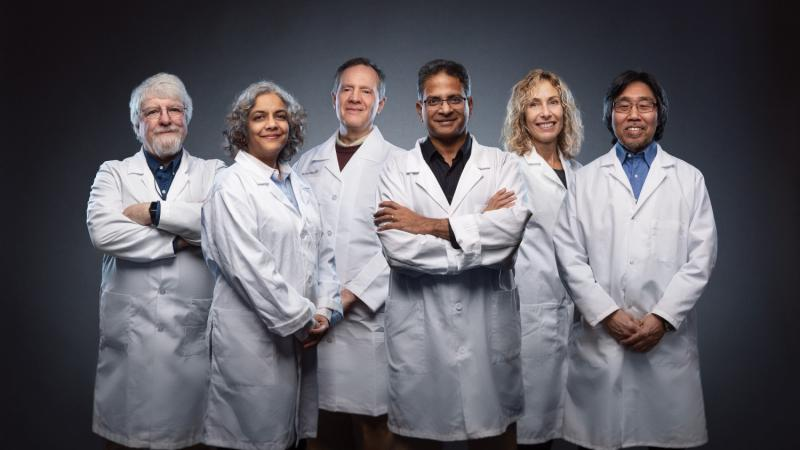 Here are some of the Iowa State researchers working with the Nanovaccine Institute based on campus, left to right: Michael Wannemuehler, Surya Mallapragada, Gregory Phillips, Balaji Narasimhan, Marian Kohut and Donald Sakaguchi. Photo by the Iowa State University Foundation.
