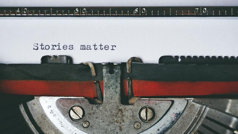 "Closeup of ""Stories matter"" text on a classic typewriter."