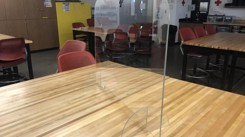 Plexiglass shield divider on a table