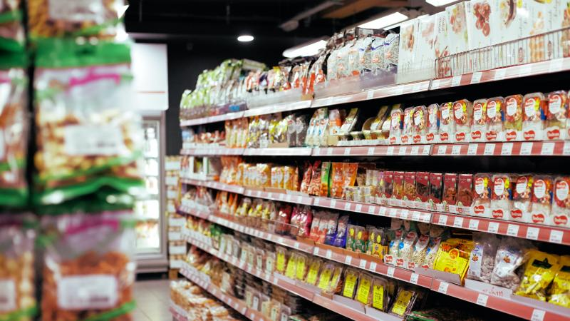 Grocery shelf stocked with packaged food items